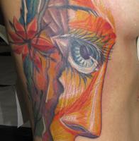 6a79ff0376f2e0bfb0484b6e4201ea986b752a68_large_face_tattoo_ribs.jpg