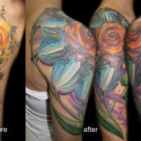 e4d073c17823e5a06d35659420a4417274482241_flowers_tribal_sun_tattoo_coverup.jpg